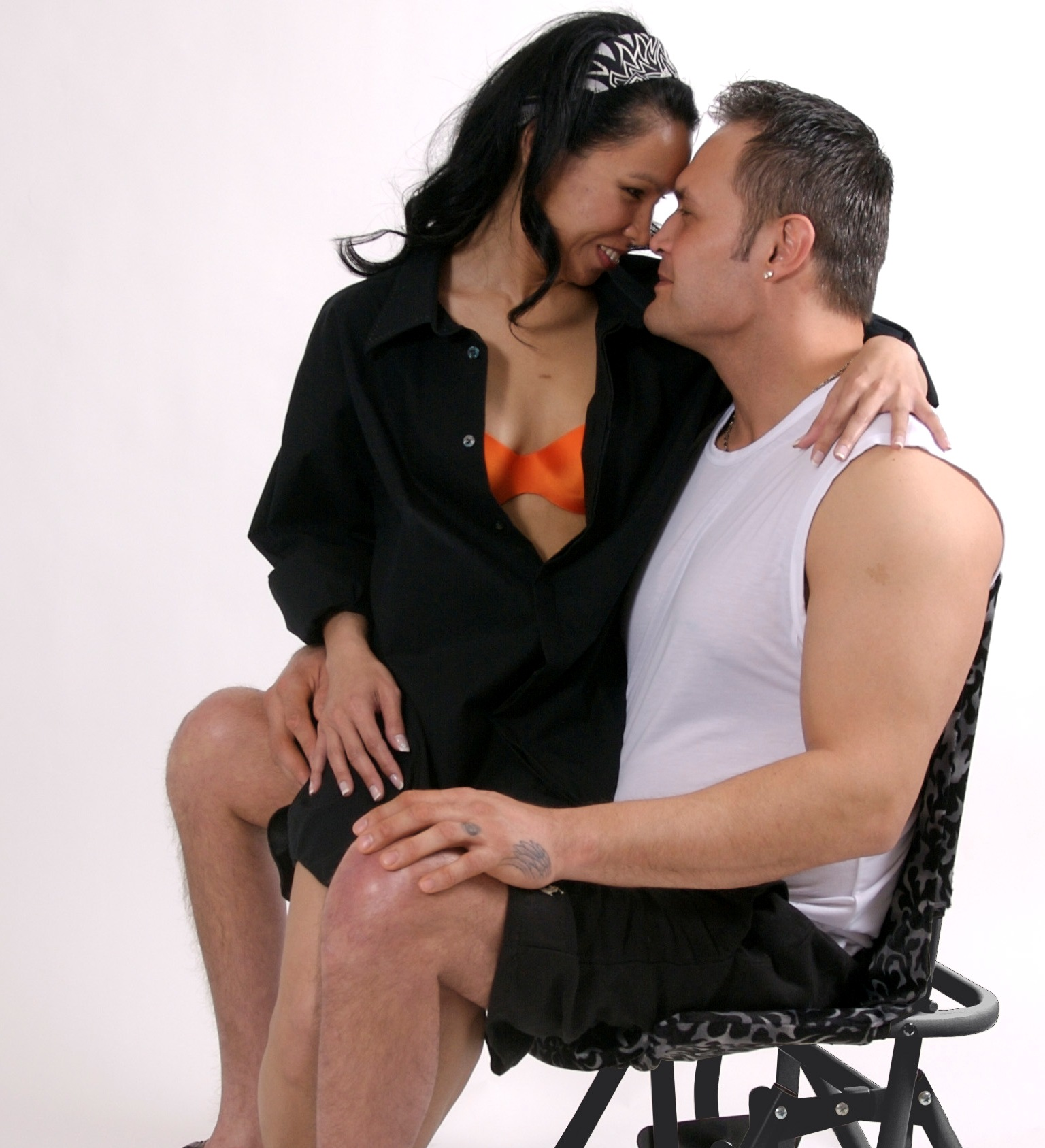 A loving couple sitting on the IntimateRider glider chair.