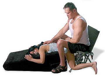 A clothed couple demonstrates a comfortable position with the IntimateRider Adventure Set.